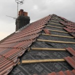 New Tiled Roof Being Laid